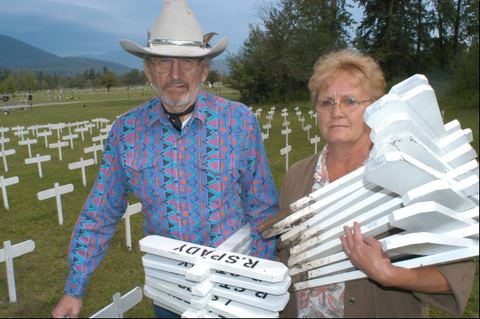 Les Skramstad and Gayla Benefield with just some of the crosses made for a Memorial Day service for those in Liby who died from asbestos related disease from the lethal fibers from the vermiculite mine.  Les died two years after the photo was taken.   (c) a. schneider